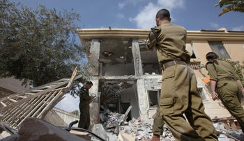 File photo: Israeli Home Front Command soldiers at a house his by a rocket fired from Gaza, in the southern city of Be'er Sheva, October 17, 2018.