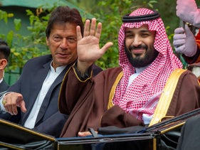 Pakistan's Prime Minister Imran Khan and Saudi Crown Prince Mohammed Bin Salman riding in a carriage during a welcome ceremony in Islamabad. February 18, 2019