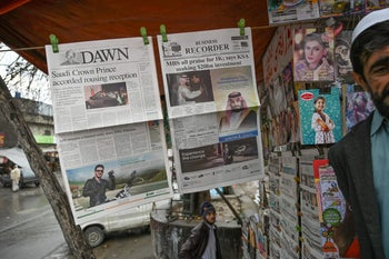 Morning newspapers with front-page-coverage of Saudi Arabian Crown Prince Mohammed bin Salman are pictured at a roadside stall in Islamabad on February 18, 2019