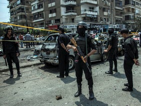 File Photo: Egyptian policemen stand guard at the site of a bombing that killed Egypt's top prosecutor, Hisham Barakat, who oversaw cases against thousands of Islamists, in Cairo, June 29, 2015.
