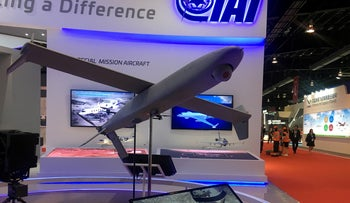 FILE PHOTO: A drone model is seen on display at the booth of drone maker Israel Aerospace Industries at the Singapore Airshow, February 8, 2018.
