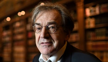 File Photo: Alain Finkielkraut poses in the French Academy's library, December 1, 2016