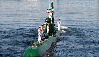 File Photo: Iran's navy members stand on Ghadir-942 submarine in southern port of Bandar Abbas, Iran, at the mouth of the strategic Strait of Hormuz, Thursday, November 29, 2018.