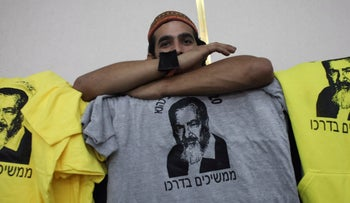 """A memorial event in Jerusalem marking 20 years since the death of Rabbi Meir Kahane, October 2010. The T-shirt says """"Continuing on his path."""""""