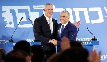 Benny Gantz and Yair Lapid deliver a joint press conference after announcing the launch of their joint party, Blue and White, February 21, 2019.