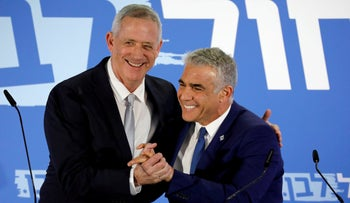 File photo: Benny Gantz and Yair Lapid in a political event in Tel Aviv, Israel, February 21, 2019.