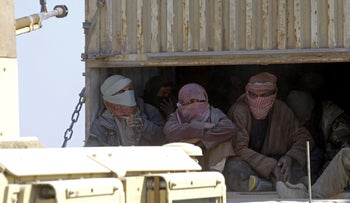 Islamic State fighters who surrendered to Kurdish-led forces are transported out of ISIS' last holdout of Baghouz, Syria, February 20, 2019.