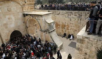 Palestinian Muslims enter the Golden Gate near Al-Aqsa Mosque in Jerusalem's Old City, February 22, 2019.