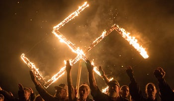 FILE PHOTO: Supporters of the National Socialist Movement, a white nationalist political group, give Nazi salutes in Georgia, U.S, April 21, 2018.