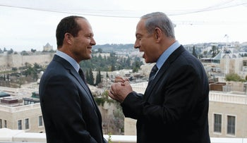 Former Jerusalem Mayor Nir Barkat and Prime Minister Netanyahu, respectively first and fourth richest politicians in Israel according to the Forbes ranking, speak in Jerusalem, on February 23, 2015.