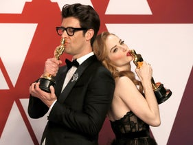 """Guy Nattiv and Jaime Ray Newman celebrate backstage with their awards for Best Live Action Short Film for the film """"Skin,"""" February 24, 2019."""