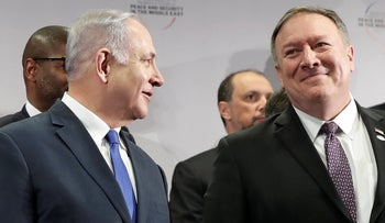 Israeli Prime Minister Benjamin Netanyahu, left, talks to United State Secretary of State Mike Pompeo at a conference on Peace and Security in the Middle East in Warsaw, Poland, Thursday, February 14, 2019.