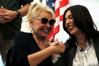 American comedian, Roseanne Barr, holds hands with Israel's Minister of Culture and Sport, Miri Regev, during their meeting in Jerusalem's Old City January 27, 2019