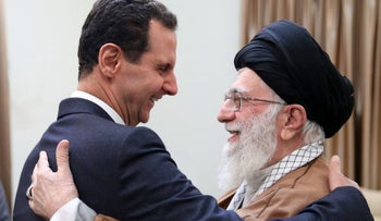 A handout picture provided by the office of Iran's Supreme Leader Ayatollah Ali Khamenei on February 25, 2019 shows him hugging Syrian President Bashar Assad in Tehran.