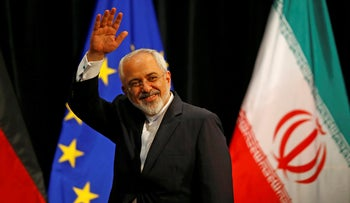 Iranian Foreign Minister Mohammad Javad Zarif waves after a plenary session at the United Nations building in Vienna, Austria, July 14, 2015.