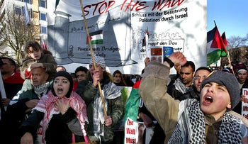 FILE PHOTO: Palestinian protesters demonstrate in front of the International Court of Justice in The Hague, The Netherlands February 23, 2004.
