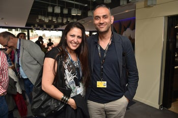 Kamal Aljafari, right, attending the Cannes Film Festival with actress Afef Ben Mahmoud, May 2016.
