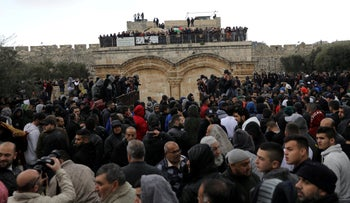 Palestinian Muslims gather near the Golden Gate near Al-Aqsa mosque in Jerusalem's Old City February 22, 2019.