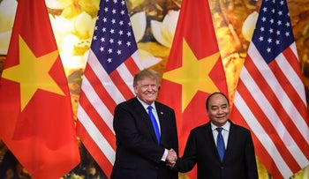 U.S. President Donald Trump shakes hands with Vietnam's Prime Minister Nguyen Xuan Phuc befoer a meeting at the Government Office in Hanoi on February 27, 2019.