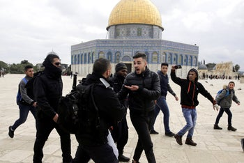 Israeli police confronts Palestinians in front of the Dome of the Rock mosque in Jerusalem, February 18, 2019.