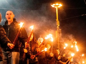 Members of nationalist organizations parade with torches during a march to commemorate Bulgarian general and Nazi collaborator Hristo Lukov, in the centre of Sofia. February 16, 2019