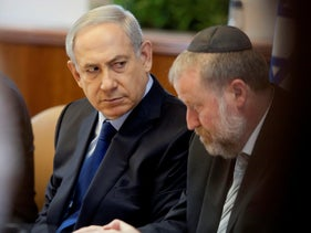 Prime Minister Benjamin Netanyahu next to Avichai Mendelblit during a cabinet meeting in 2015.