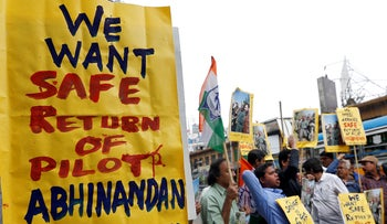 Demonstrators hold placards and shout slogans during a protest demanding the release of an Indian Air Force pilot after he was captured by Pakistan, in Kolkata, India, February 28, 2019.