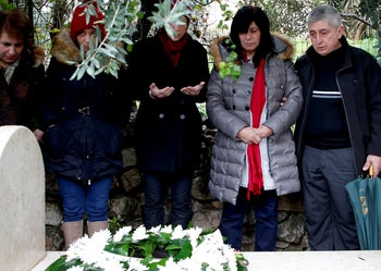 Popular Front for the Liberation of Palestine (PFLP) member Khalida Jarrar, 56, prays over the grave of her father following her release from an Israeli jail on February 28, 2019, Nablus in the occupied West Bank. - Israel released from custody the Palestinian politician who had been held without trial for 20 months over links to an organisation it considers a terrorist group, the Israeli prison service said. She was arrested on July 2, 2017 for being a senior member in the PFLP, a movement considered a terrorist organisation by Israel, the United States and the European Union.