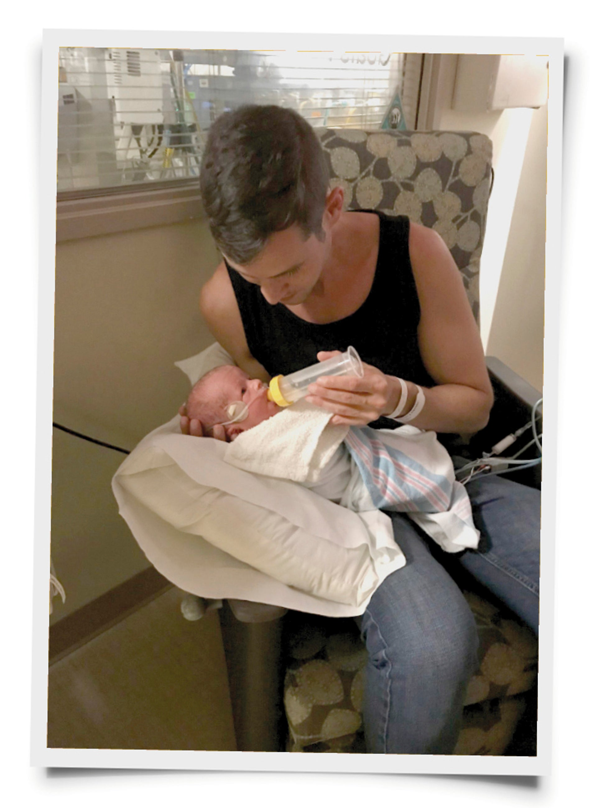 At the NICU. The surrogate mother knitted the twins wool blankets and volunteered to pump breast milk for them.