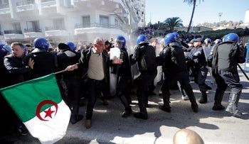 Police try to disperse people trying to reach the government palace during a protest against President Abdelaziz Bouteflika in Algiers, Algeria, March 1, 2019.