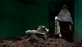 A fin of an exploded mortar inside a damaged house that locals say was fired by Pakistani troops in India's Mendhar near the border with Pakistan on March 1, 2019.