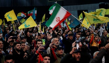Hezbollah supporters shout slogans and wave Lebanese, Hezbollah and Iran flags, during a rally in southern Beirut, Lebanon, Feb. 6, 2019.