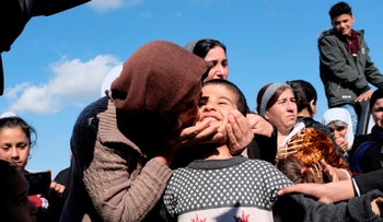 Dilbar Ali Ravu, 10, is kissed by his aunt Dalal Ravu after Yazidi children were reunited with their families in Iraq after five years of captivity with the Islamic State, Saturday, March 2, 2019.