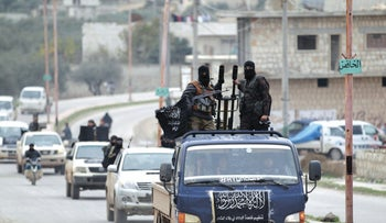 FILE PHOTO: Members of Al Qaieda's Nusra Front drive in a convoy in the southern Idlib, December 2, 2014