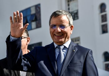 Retired Algerian army general Ali Ghediri waves as he arrives to submit his candidacy before the constitutional council for the upcoming presidential election, March 3, 2019.