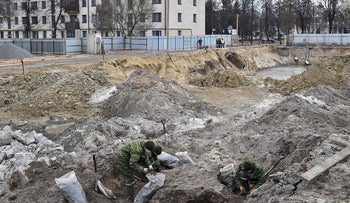 Belarus' servicemen excavate a mass grave for the prisoners of a Jewish ghetto set up by the Nazis during World War Two, that was uncovered at a construction site in the city of Brest, on February 27, 2019