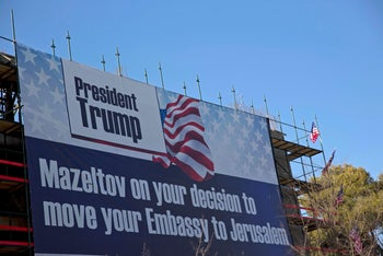 FILE Photo: A sign congratulating U.S. President Donald Trump for moving the embassy hangs in Jerusalem, 2018.