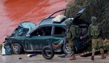 Israeli soldiers at the scene of the car-ramming near Ramallah, March 4, 2019.