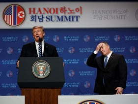 President Donald Trump speaks as Secretary of State Mike Pompeo looks on during a news conference after a summit with North Korean leader Kim Jong Un in Hanoi, February 28, 2019.