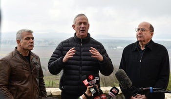 Benny Gantz speaks to members of the media during a tour of the Golan Heights, alongside Moshe Ya'alon and Yair Lapid, March 4, 2019.