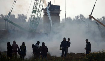 Tear gas is fired by Israeli forces as Palestinian demonstrators protest at the Israel-Gaza border fence, in the southern Gaza Strip March 1, 2019.