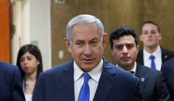 Israeli Prime Minister Benjamin Netanyahu arrives for the weekly cabinet meeting in Jerusalem, Sunday, March 3, 2019.