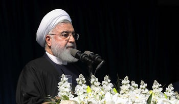 Iran's President Hassan Rohani speaks to the crowed in northern city of Lahijan, Iran, March 6, 2019.