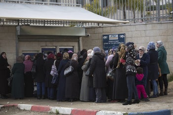 Women stand in line at the employment office in Wadi Joz, East Jerusalem.