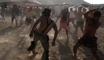 File photo: Attendees dance at a party during the Midburn festival in southern Israel, May 21, 2015.