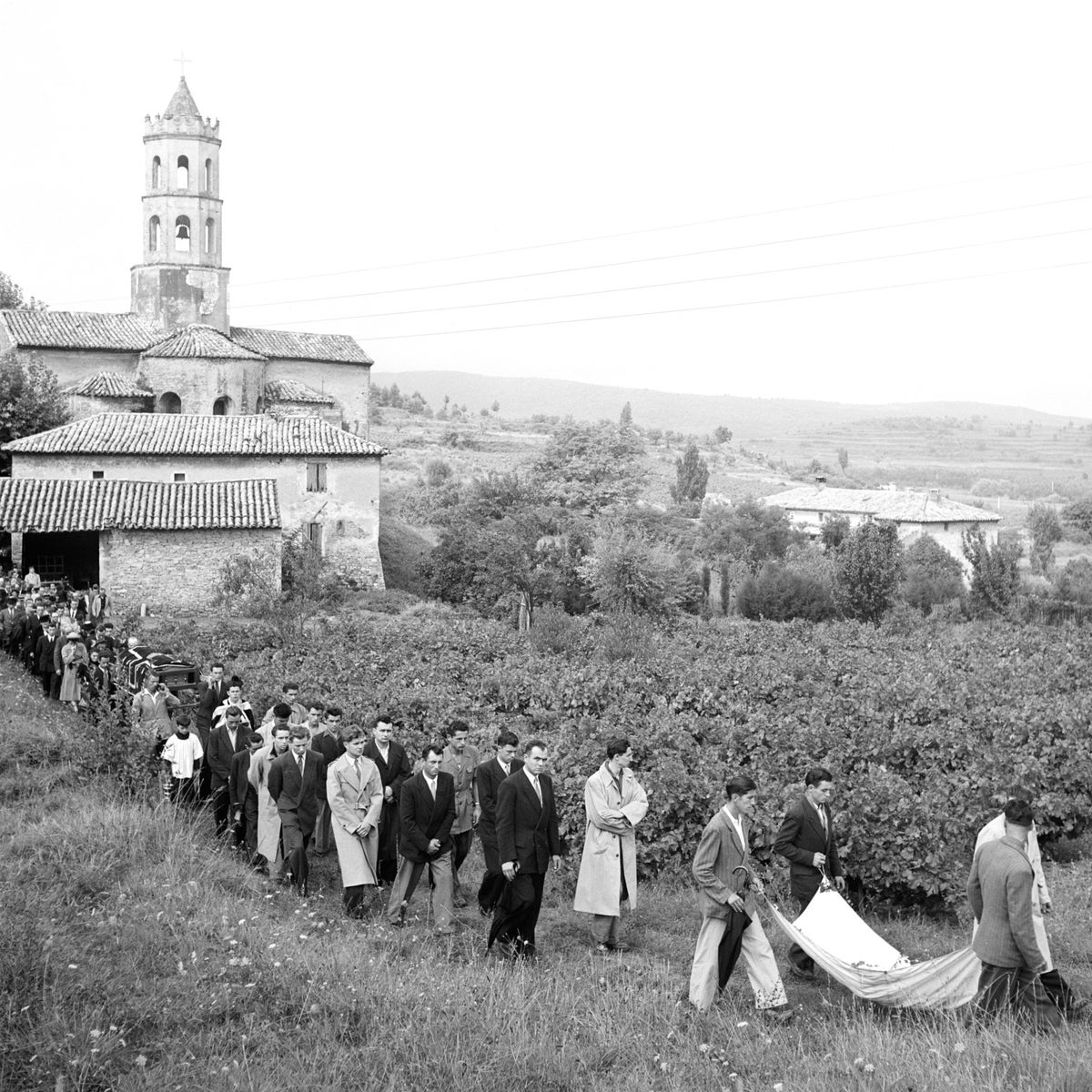 The funeral procession for a victim of the Pont-Saint-Esprit incident.