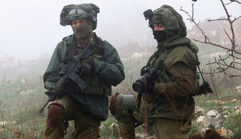 FILE PHOTO: Israeli soldiers are seen from Meis al-Jabal village in south Lebanon, December 9, 2018