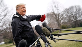 Donald Trump speaks to the press before boarding Marine One at the White House on March 8, 2019, in Washington, DC.