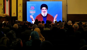 Hezbollah leader Sayyed Hassan Nasrallah delivers a speech via a video link, in a southern suburb of Beirut, Lebanon, March 8, 2019.