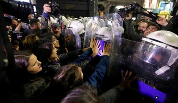 Police try to disperse a march marking International Women's Day in Istanbul, Turkey, March 8, 2019.